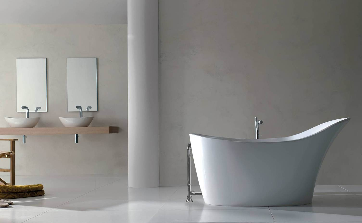 Victoria + Albert Amalfi bath in volcanic limestone is distributed in Quenesland by Luxe by Design, Brisbane.