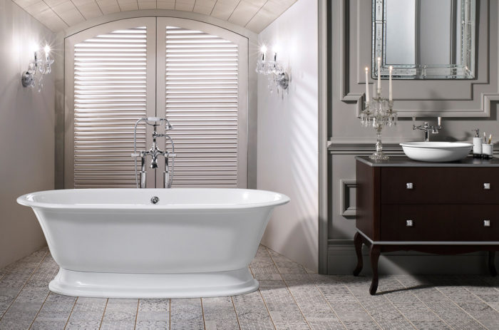 Victoria + Albert Elwick traditional bath in volcanic limestone is distributed in Quenesland by Luxe by Design, Australia.