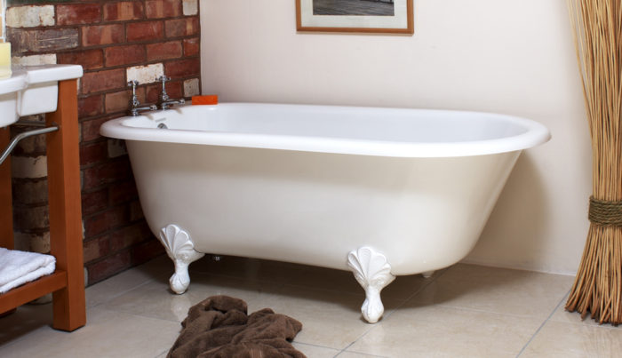 Victoria + Albert Wessex traditional bath in volcanic limestone is distributed in Queensland by Luxe by Design, Australia.